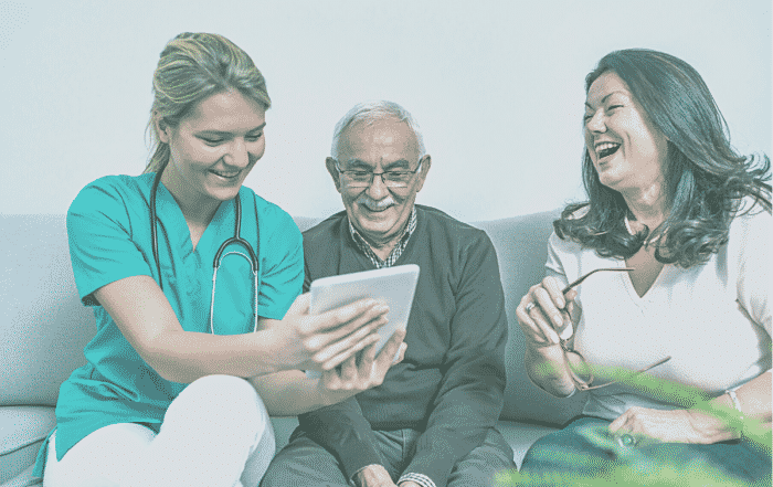 caregiver laughing with patient